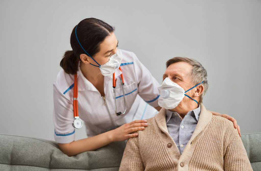 Senior man meets doctor to discuss his options for vaccine.