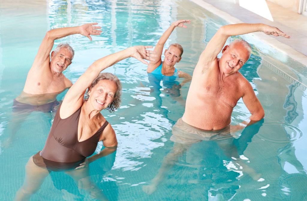 Senior group taking part in water aerobics